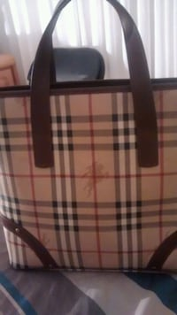 Classic authentic real leather burberry $200 Laval, H7W 4E6