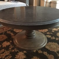 Round brown wooden pedestal table COLUMBIA