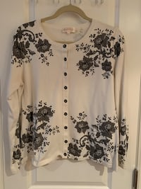 White sweater with grey floral design