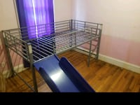 Twin loft bed frame with slide. Like new condition.