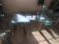 clear glass-top table with black steel base New Orleans, 70117