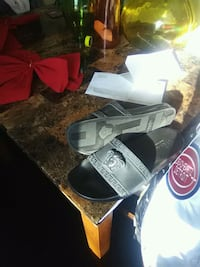 pair of gray-and-black Versace slides Detroit, 48205