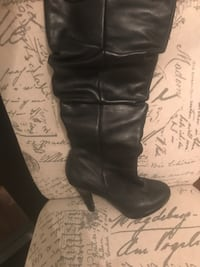pair of black leather knee-high boots Toronto, M9C 3Z4