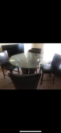 Glass dining table with 4 faux leather chairs  Long Beach, 90806