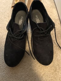 pair of black suede shoes