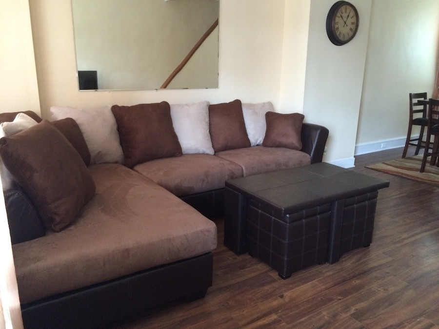 Photo Sectional sofa with ottoman and two pull out ottoman storage seats