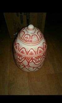 white and red floral ceramic vase