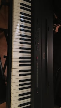 Roland 7 octave digital piano with case and stand. Buena Park, 90620