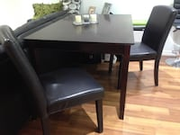 Rectangular brown wooden table with four chairs dining set Toronto, M4C 5C1