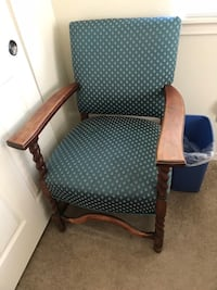 Brown wooden frame gray padded armchair in good condition