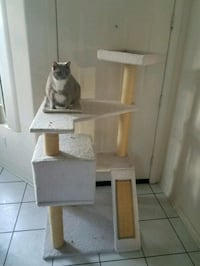 Cat tree wuth scratching posts and hiding place