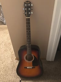 Brown and black acoustic guitar Niles, 44446