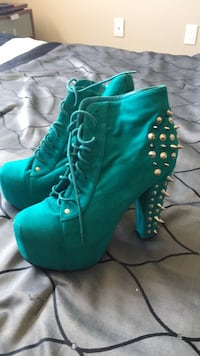 pair of green leather heeled booties Calgary, T2W