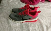 pair of gray-and-orange Nike running shoes Kitchener, N2B 2T9