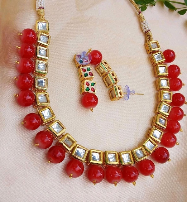 red and yellow beaded necklace