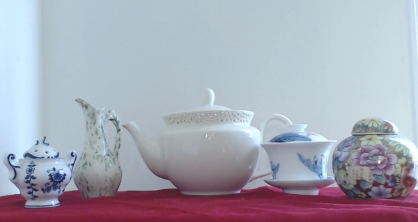 white ceramic pitcher and bowl