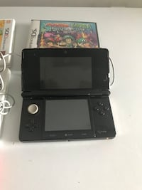 black Nintendo 3DS with game cases Brantford, N3T 4Z3