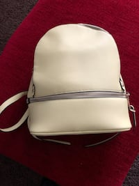 New yellow backpack purse with 2 outer zippers and several inside pockets.  It is brighter yellow than in picture, no name brand. Meridian, 83642