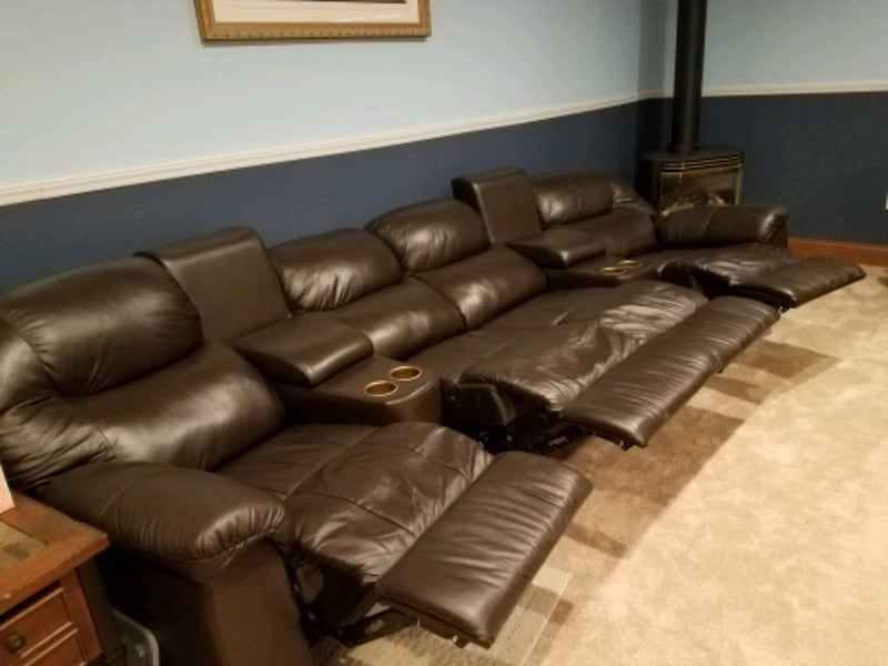 Leather stadium seating couch cf8966f9-81e5-44ac-bc5c-9e53a95630a6