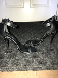 pair of black leather ankle strap heeled sandals Calgary, T3J 4C2