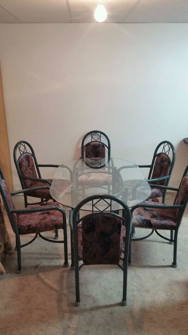 Glass top table , and six arm chairs ,