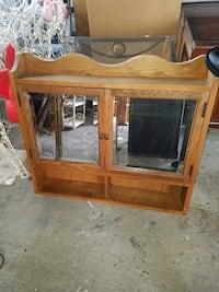 brown wooden framed glass cabinet Lincoln Park, 48146