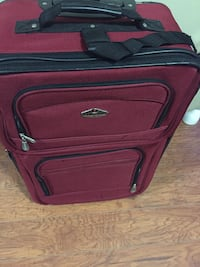 Red and black luggage bag/suitcase in great condition  Toronto, M1J 3K2