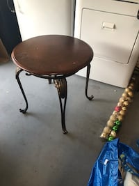 Round brown wooden-top side table with brass base Jacksonville, 32218