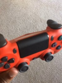 orange and black Sony PS4 controller District Heights, 20747
