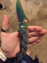 Green and iridescent pocket knife Broken Arrow, 74012