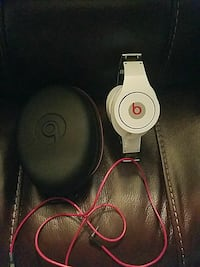 white Beats by Dr. Dre corded headphones with case