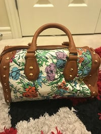 white, brown, and teal floral leather handbag