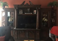 black flat screen TV and brown wooden TV hutch Clinton, 20735