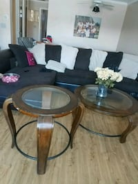 round brown wooden framed glass top table