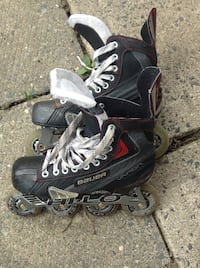 pair of black inline skates Montréal