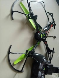 black and green quadcopter Laval, H7T 2A4