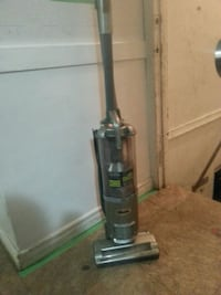 black and gray upright vacuum cleaner 2469 km