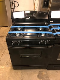 GE black gas stove working perfectly