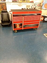 red and gray tool cabinet