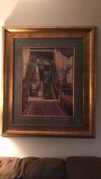 Gold framed painting of house