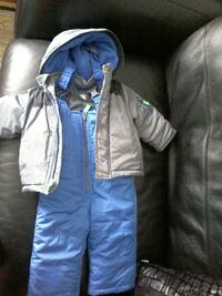 gray zip-up hoodie and blue overall pants
