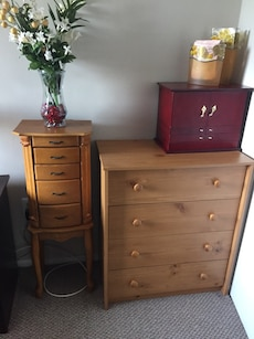 brown wooden 4-drawer dresser and jewelry chest