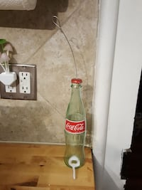Coca-Cola bottle bird feeder