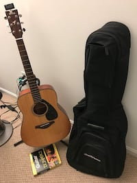 brown and black acoustic guitar with gig bag Burke, 22015