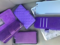 Several purple leather long wallets and iphone case