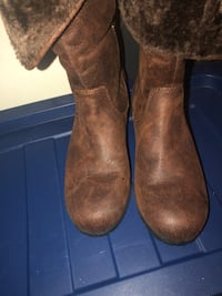 pair of brown suede boots 229 mi