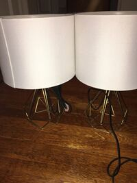 Two white and gold table lamps