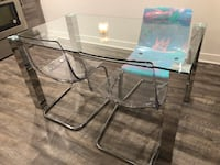 rectangular clear glass top table with four chairs Montréal, H4R 2K8