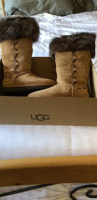 Pair of ugg knee-high boots with fur with box
