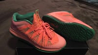 pair of pink-and-green Nike basketball shoes